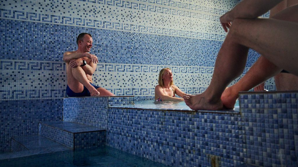 Alpinists relaxing in a bathhouse in Iran