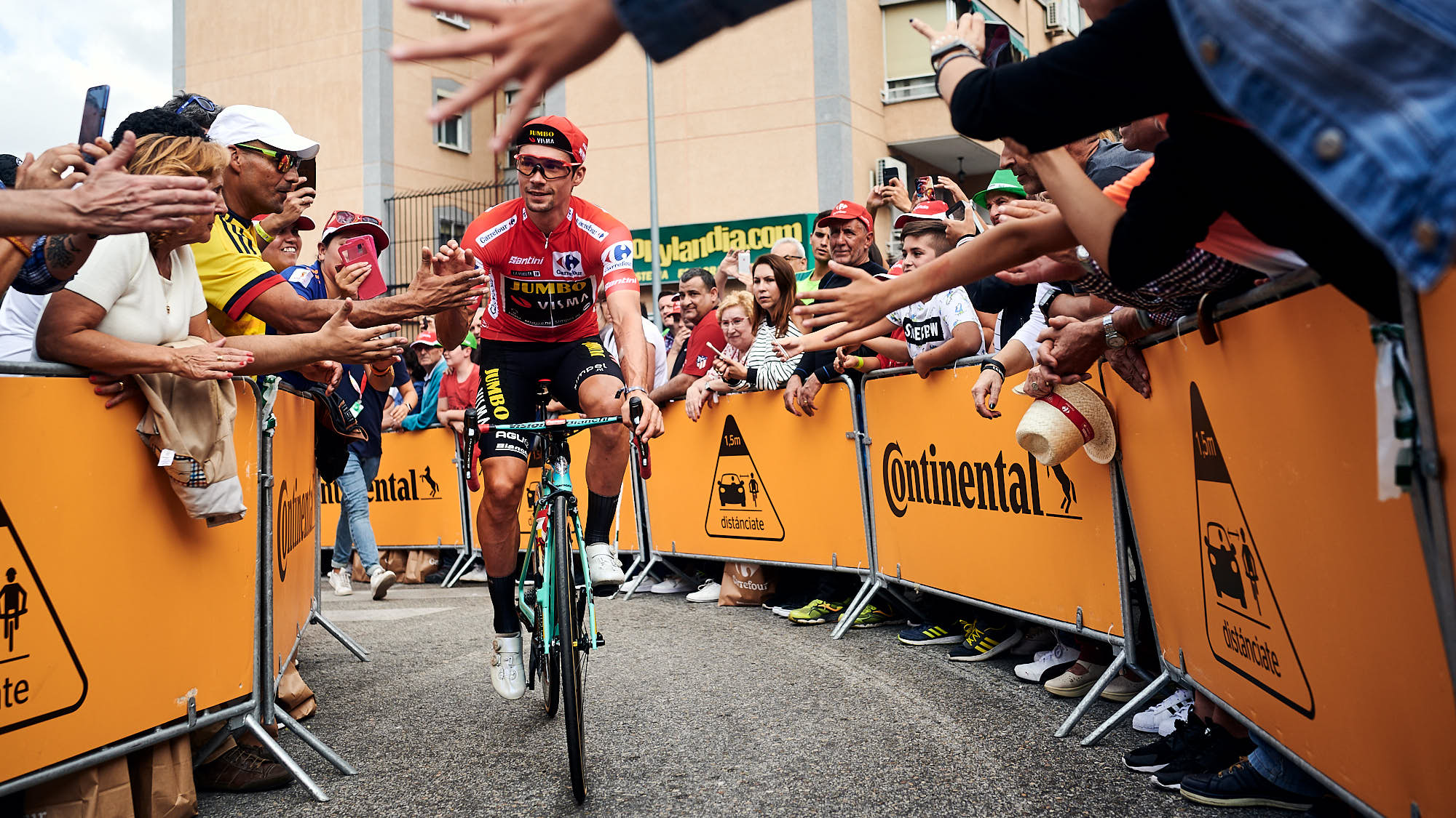 Cyclist Primoz Roglic greeting the crowd during La Vuelta in Spain