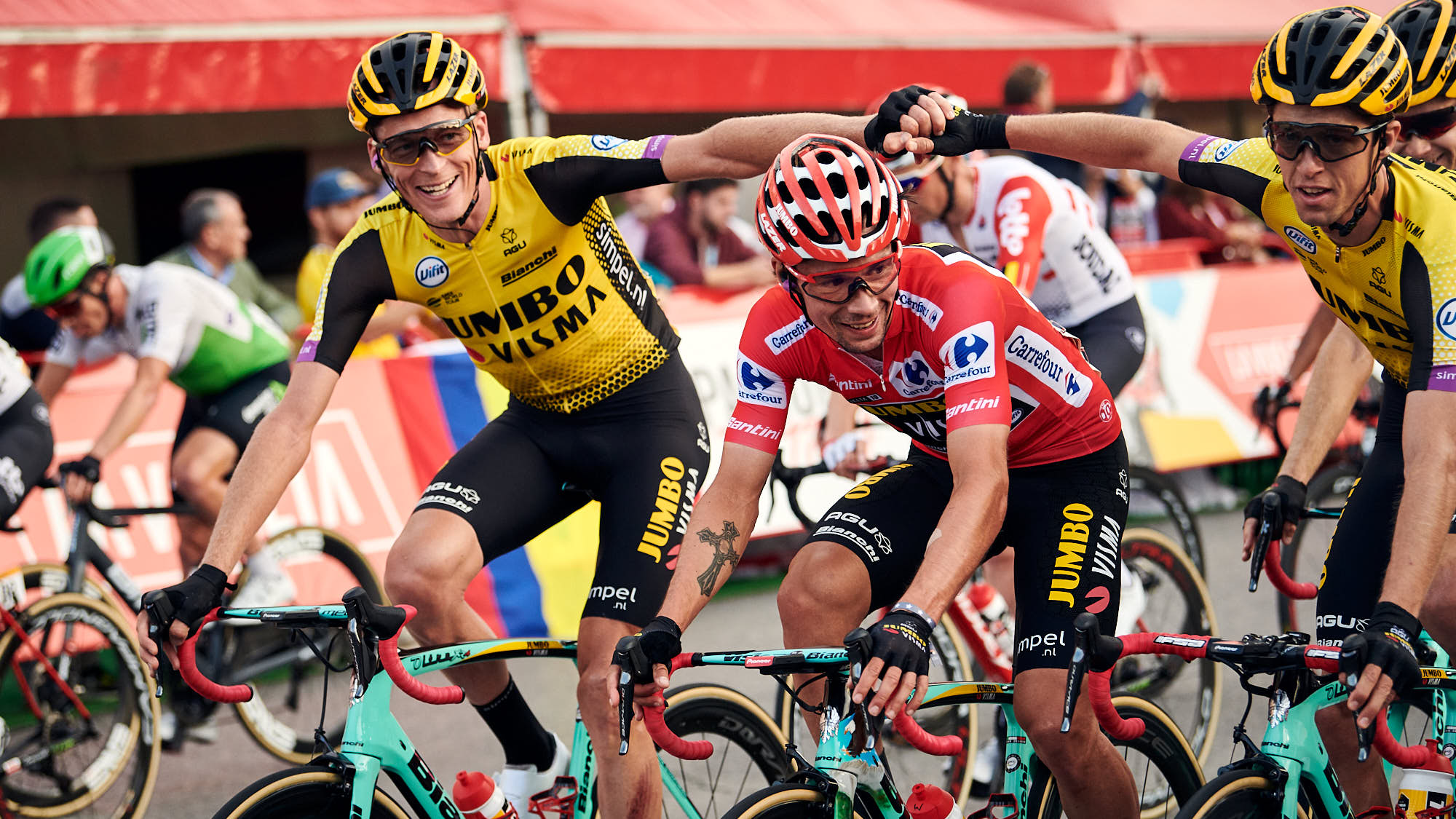 Team Jumbo-Visma cyclist celebrate while crossing the line in Madrid during La Vuelta