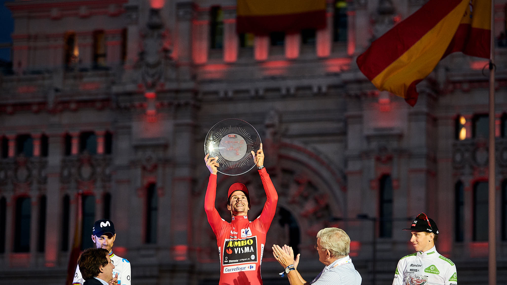 Cyclist Primoz Roglic (Jumbo-Visma) raising the Vuelta trophy in Madrid