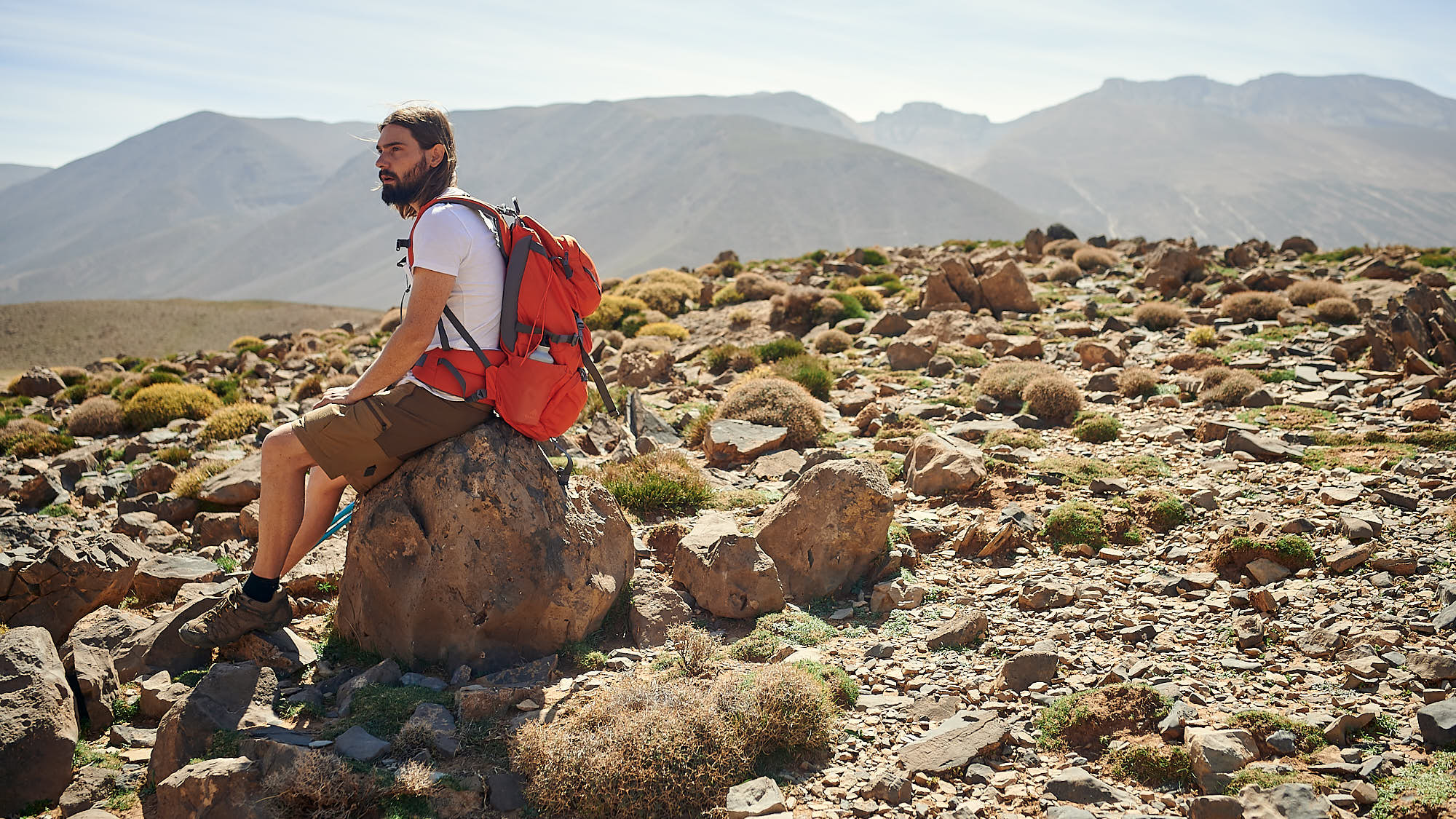 Hiker taking a rest on a boulder in Morocco