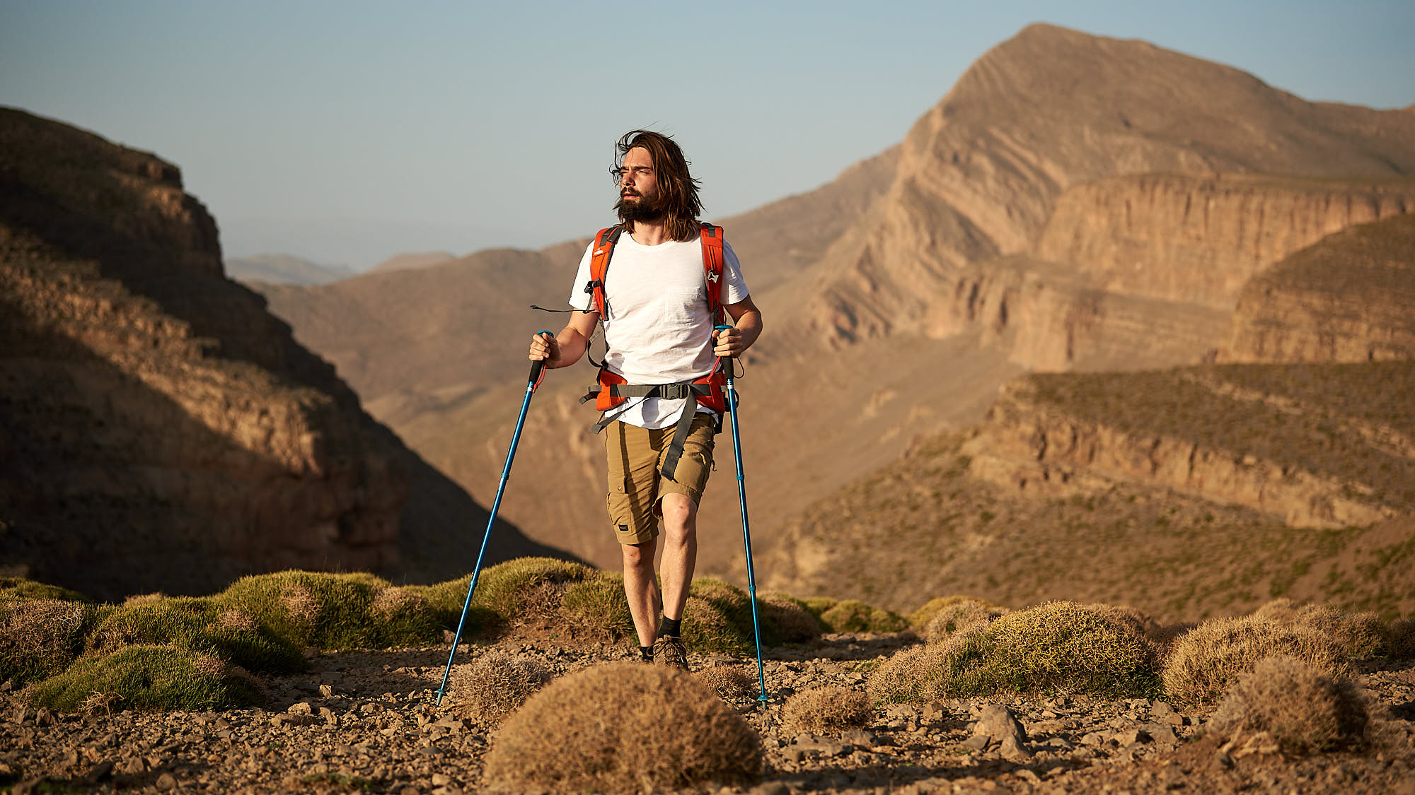 Hiker walking through the Moroccan High Atlas mountain ridge