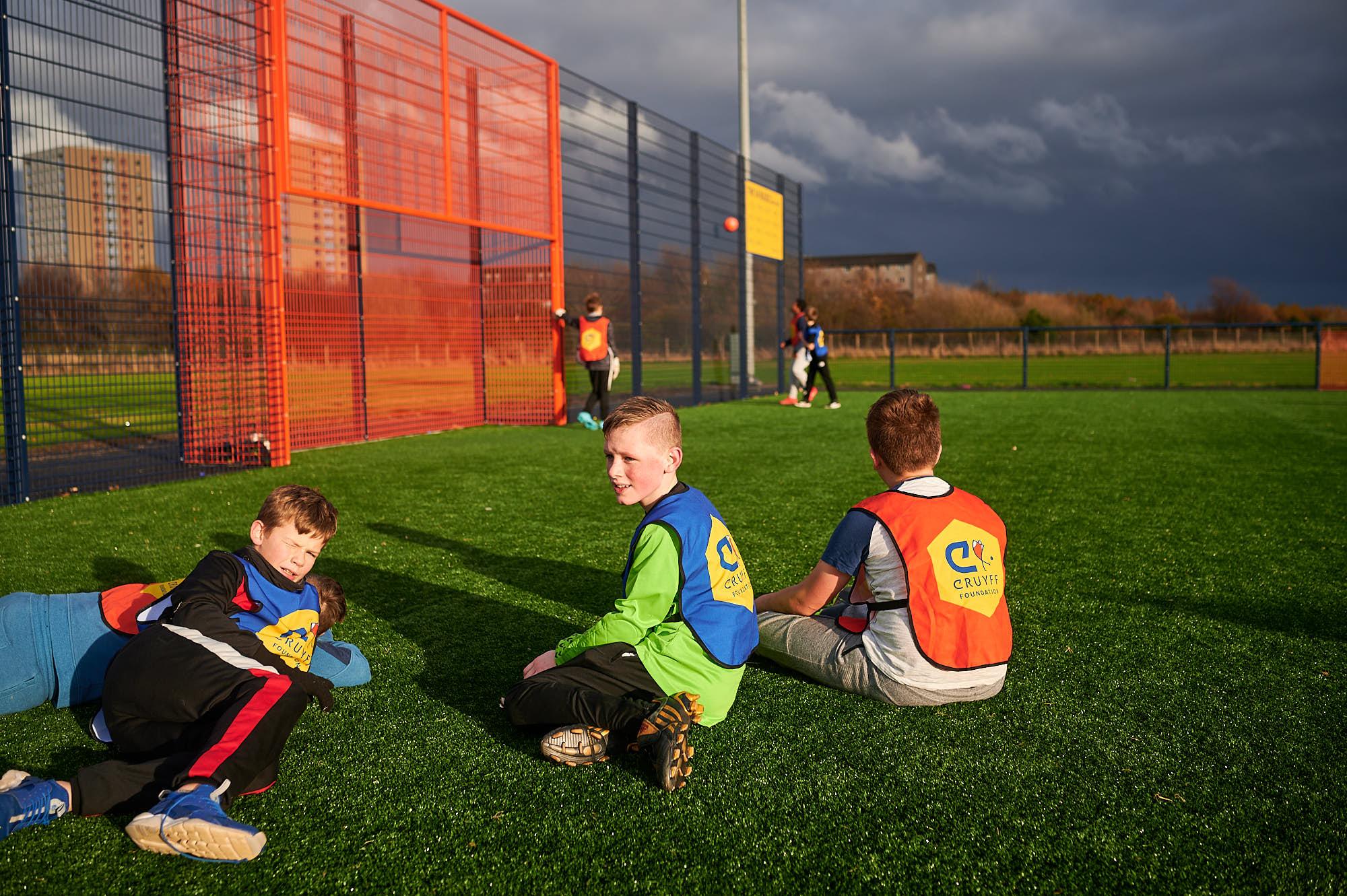 Kids relaxing on a Cruyff Court in Aberdeen