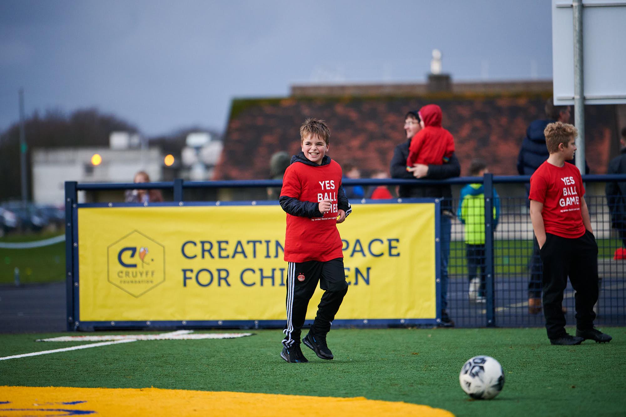 Children playing football on a Cruyff Court