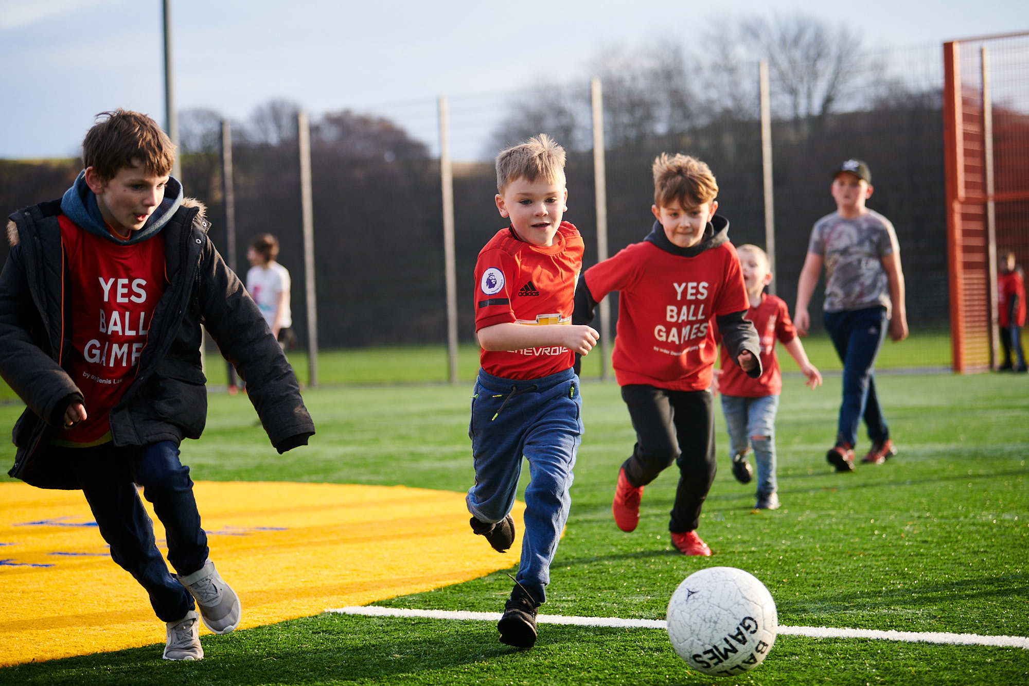 Young kids playing football on a Cruyff Court in Aberdeen