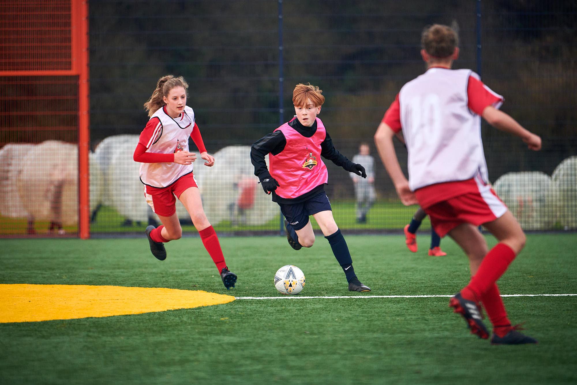 Kids playing football on a Cruyff Court in Aberdeen, Scotland