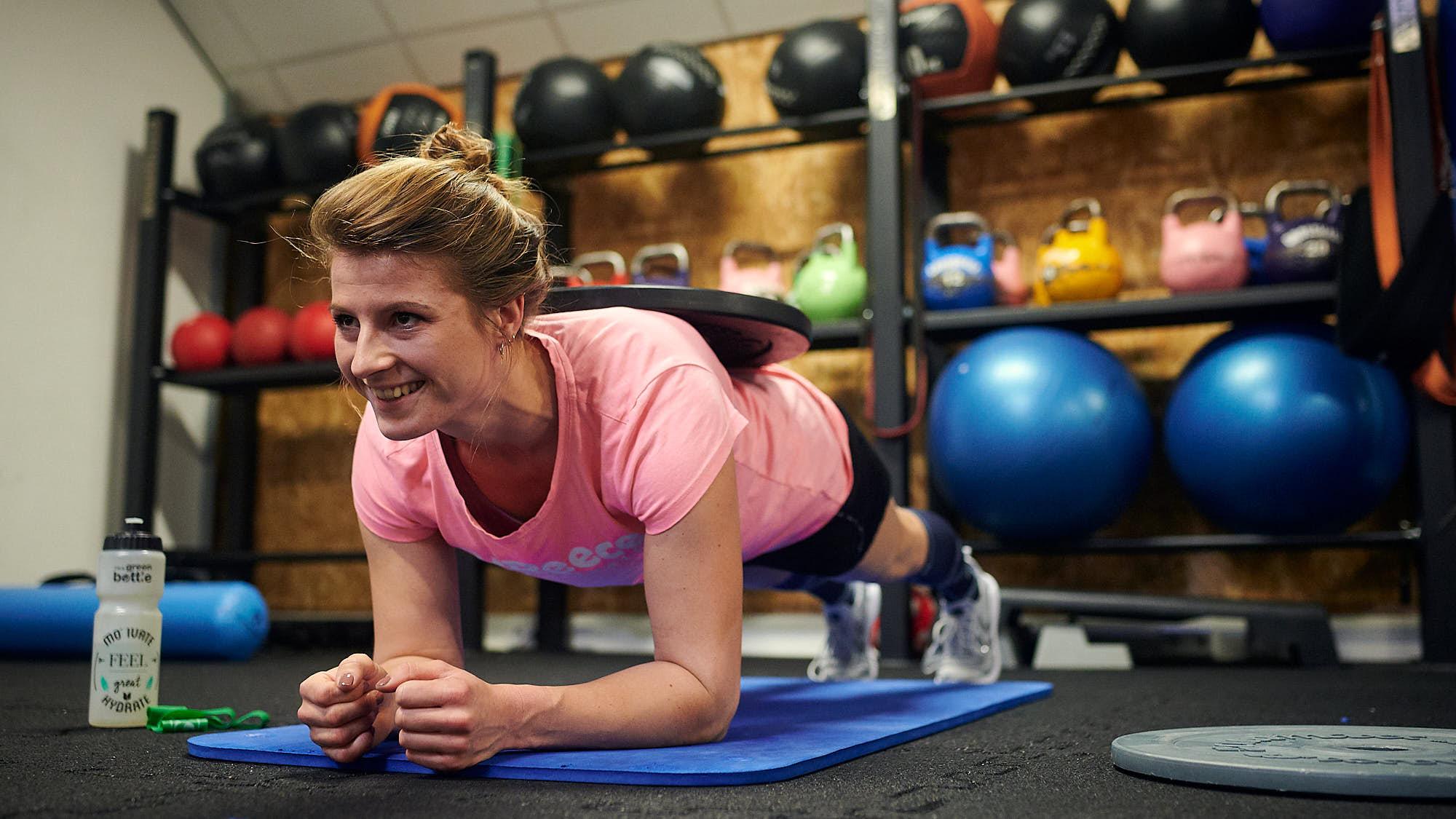 Dutch national women's hockey team keeper Josine Koning working out in a gym