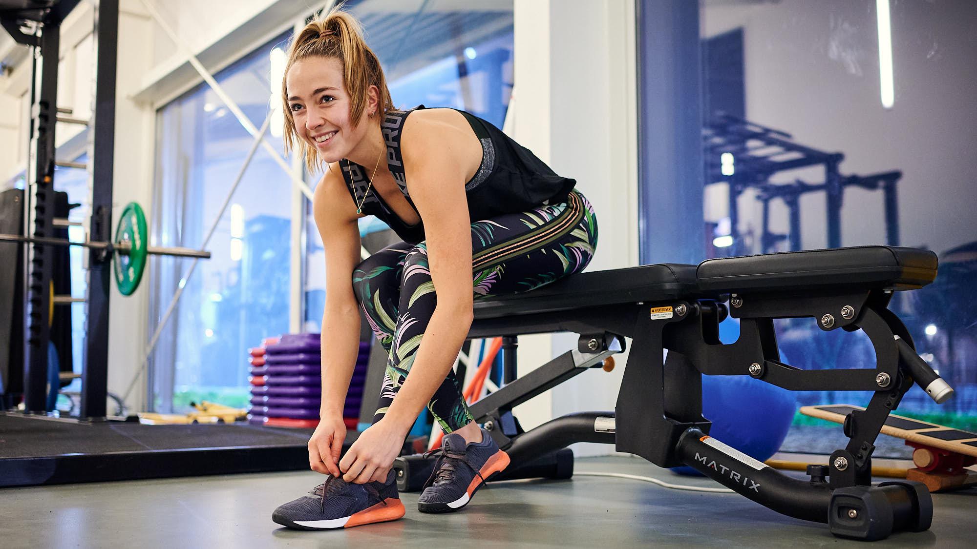 Dutch hockey athlete Renée van Laarhoven tying shoelaces