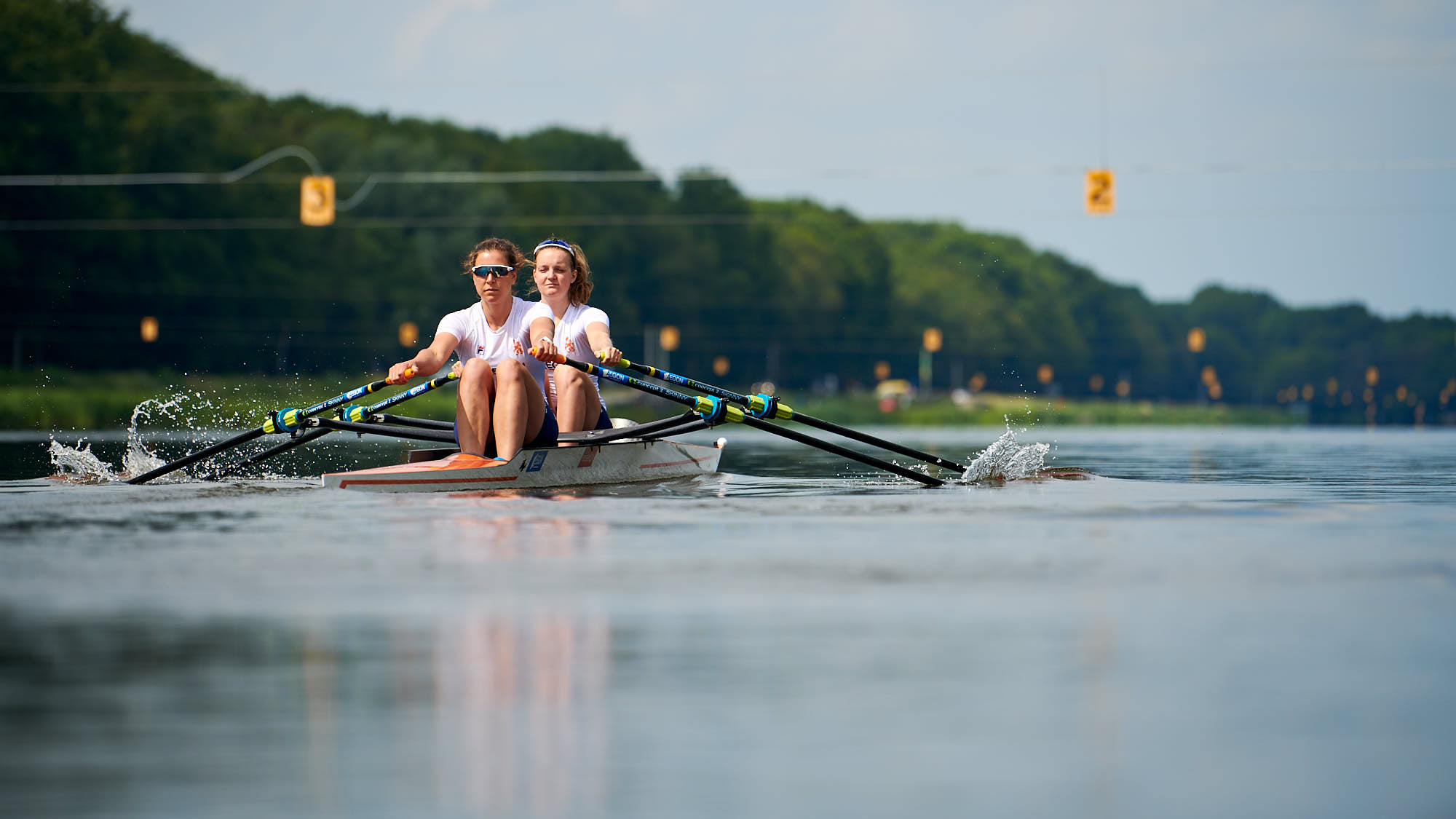 Ilse Paulis and Marieke Keijser rowing at the iconic Amsterdam Bosbaan