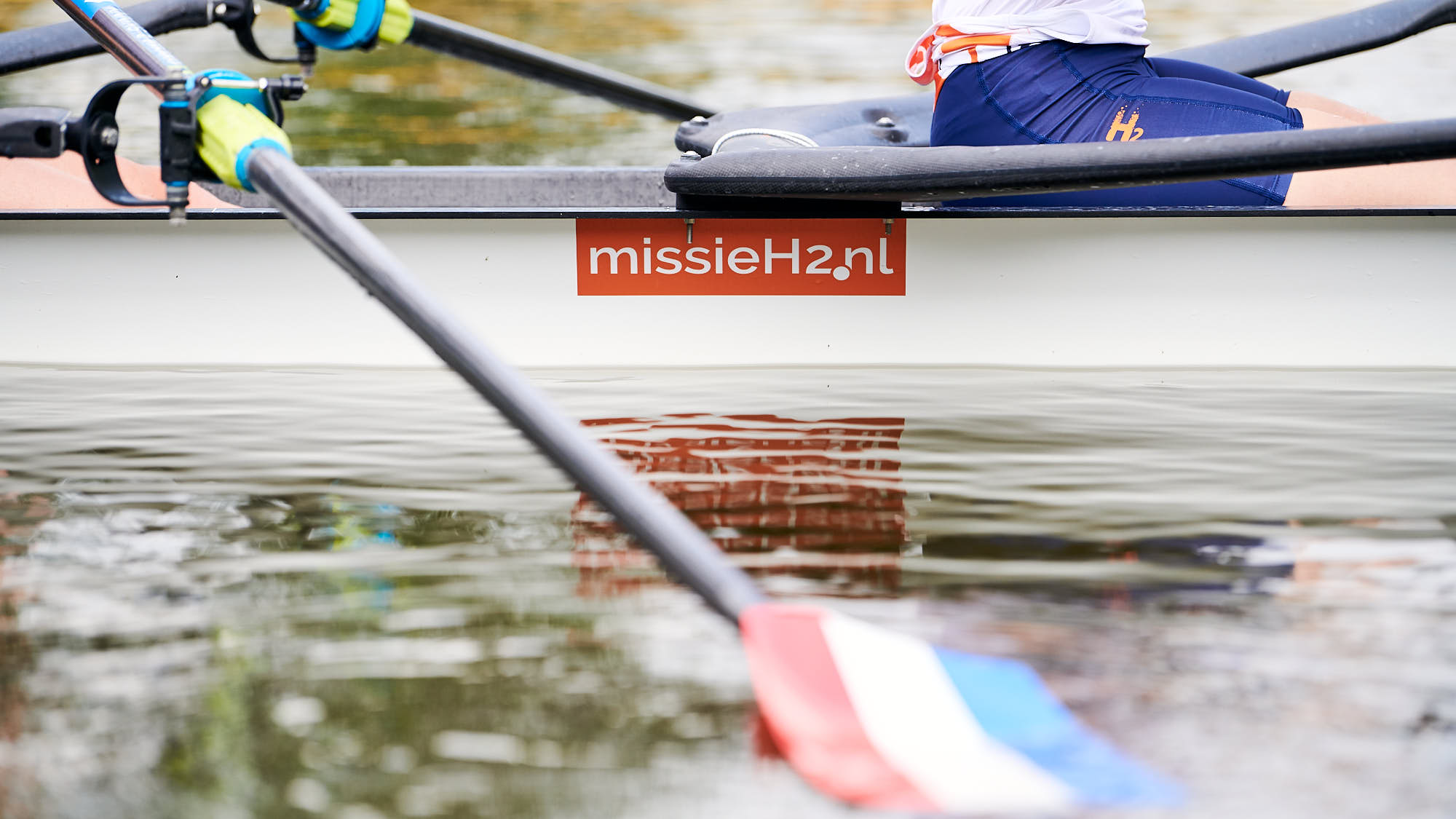 Close-up of MissieH2 logo on a boat