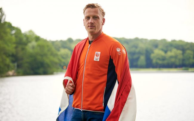Ferry Weertman wearing TeamNL vest and Dutch flag