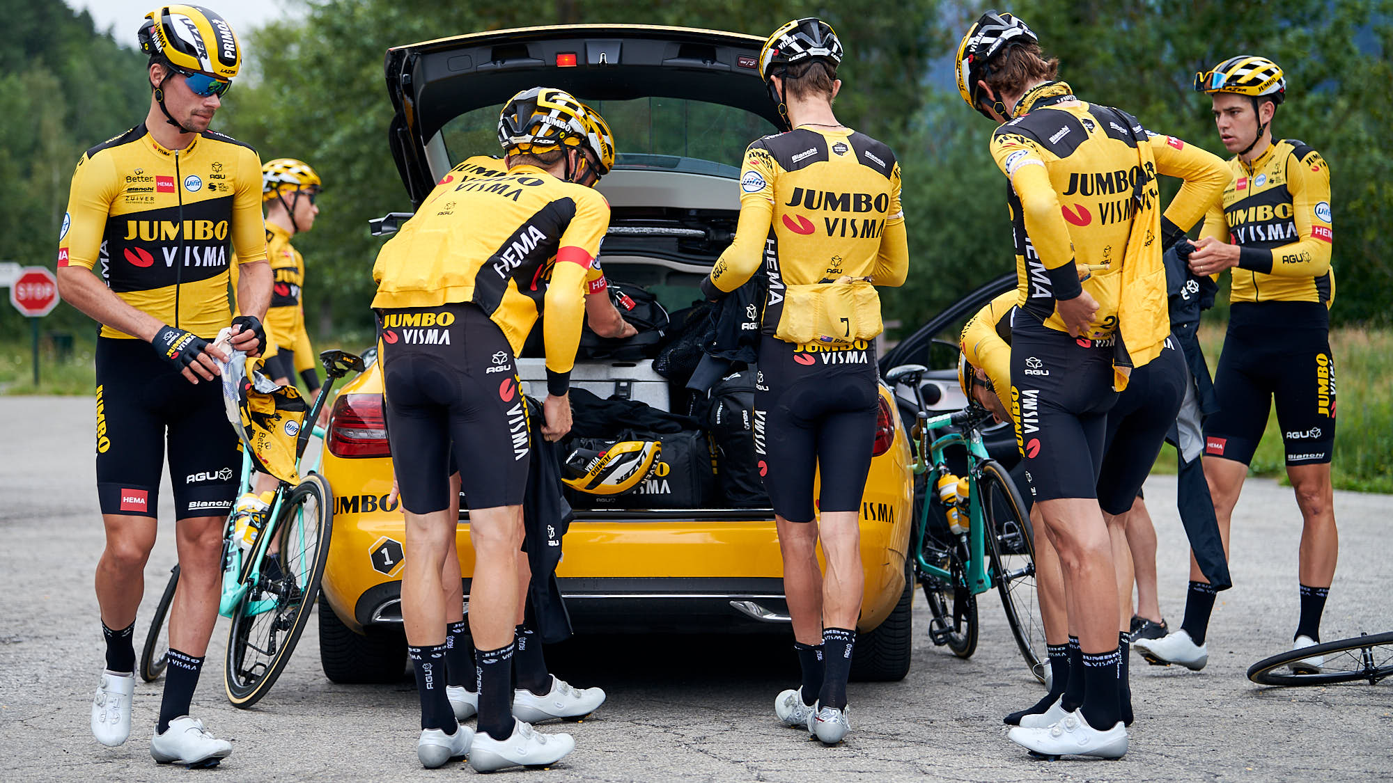Jumbo-Visma riders changing clothes during training